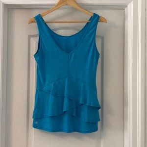 Lululemon tank with ruffles at the back.